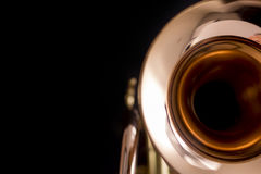 Glittering. Close up of a trumpet against black background Stock Image