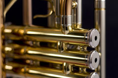 Glittering. Close up of a trumpet against black background Royalty Free Stock Image
