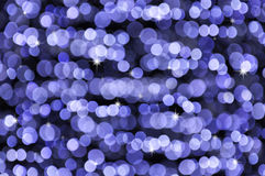Glittering defocused lights. White glow holiday background, winter blizzard Stock Photo