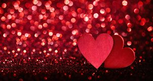 Glittering Effect With Red Hearts Stock Photo