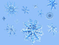 Glittering Falling Snowflakes Stock Photo