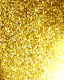Glittering gold background. With some smooth lights and sparkles Stock Image