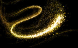Glittering gold cosmic dust tail Royalty Free Stock Photography