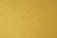 Glittering gold paper sheet texture background. S royalty free stock photography