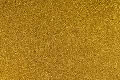 Glittering gold paper sheet texture background. Sparkling golden yellow pattern Royalty Free Stock Photos