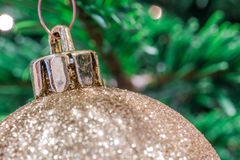 Glittering golden christmas ball Royalty Free Stock Photo