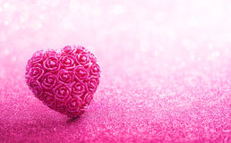Glittering Heart Shaped on Pink Background Royalty Free Stock Images