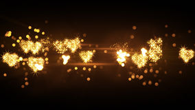 Glittering heart shapes from firework bursts Stock Photos
