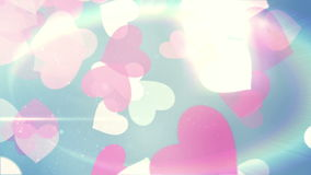 Glittering hearts on blue background stock video