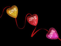Glittering hearts of love. Glittering hearts full of love bonded with a ribbon Royalty Free Stock Image