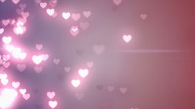 Glittering hearts on pink background stock footage
