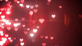 Glittering hearts on red background stock video