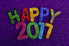 Glittering letters forming the text happy 2017 Stock Image