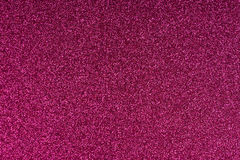 Glittering magenta paper sheet texture background. Sparkling golden red wine color pattern Stock Images