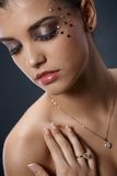 Glittering makeup and jewelry Stock Photo