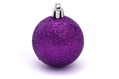 Glittering purple christmas bauble. Glitting purple christmas bauble over white Royalty Free Stock Photos