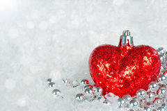 Glittering read heart with snowflakes royalty free stock images