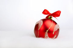 Glittering red christmas ball Stock Photos