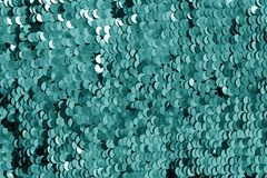 Glittering sequin texture in cyan tone stock photography