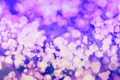 Abstract blurred and silver glittering shine bulbs lights background:blur of Christmas wallpaper decorations concept.holiday festi Royalty Free Stock Images