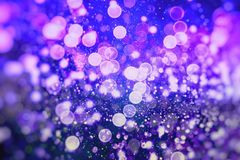 Abstract blurred and silver glittering shine bulbs lights background:blur of Christmas wallpaper decorations concept.holiday festi. Glittering shine bulbs lights Stock Photos