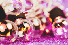 Glittering shine lights background. With violet sparkles and many little bulbs. Festive background Stock Image