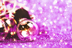 Glittering shine lights background. With violet sparkles and many little bulbs. Festive background Stock Photos
