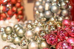 Glittering silver and pink Christmas baubles Royalty Free Stock Photography