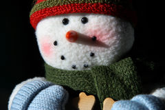 Glittering Snowman closeup with smiling face. Happy nighttime handmade snowman glittering with dark background Royalty Free Stock Images