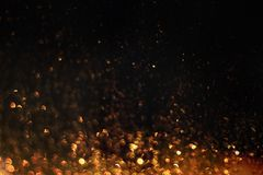 Glittering sparkles in dark royalty free stock image