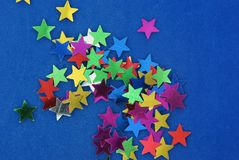 Glittering stars on blue background Royalty Free Stock Photography