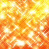 Glittering stars. Blurred yellow and red background Royalty Free Stock Photos
