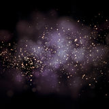 Glittering stars on bokeh background Royalty Free Stock Image