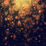 Glittering stars on bokeh background Royalty Free Stock Images