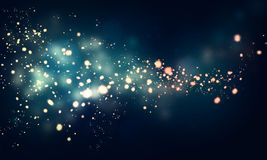 Glittering stars on dark background Royalty Free Stock Photos
