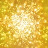 Glittering stars on golden glittering background Stock Photos