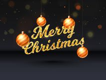 Glittering text of Merry Christmas on black blurred background d. Ecorated with hanging golden baubles stock illustration
