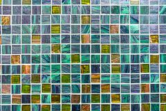 Glittering turquoise mosaic tiles. Background from some glittering turquoise mosaic tiles royalty free stock photo