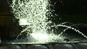 Glittering water fountain stock video footage