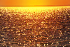 Glittering water at sunset. Royalty Free Stock Photography
