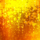 Glittering yellow background with stars Royalty Free Stock Photography