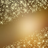 Glittering yellow background with stars. Glittering shiny yellow background with stars Stock Photo