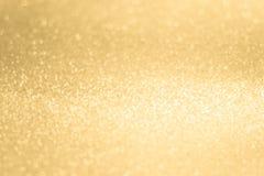 Glittery сияющая предпосылка конспекта золота светов стоковое изображение rf