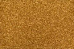 Glittery текстура Бумага яркого блеска золота Стоковые Фото