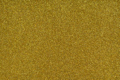 Glittery текстура Бумага яркого блеска золота Стоковая Фотография