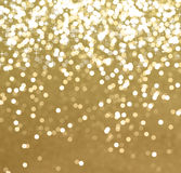 Glittery gold Christmas background. With stars and bokeh lights Stock Photo