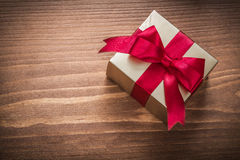 Glittery gold gift box on vintage wooden board horizontal versio Stock Photography
