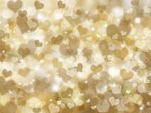Glittery gold hearts background Stock Photos