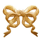 Glittery golden bow Royalty Free Stock Photos
