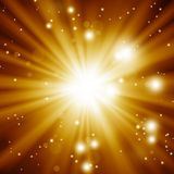 Glittery golden festive background. With rays and stars Stock Photography